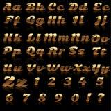 字母表和数字做了†‹在金子的†‹ 库存图片