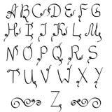 字母表在手写的字体上写字 免版税库存照片