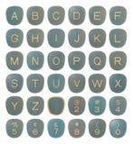字母表在葡萄酒上写字 库存图片