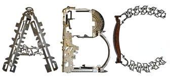 字母表在` A, B,从金属零件装配的C `上写字 免版税库存照片