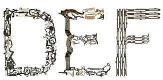 字母表在` D, E,从金属零件装配的F `上写字 图库摄影