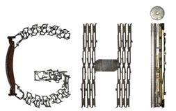 字母表在` G, H,从金属零件装配的I `上写字 库存图片