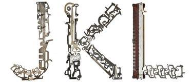 字母表在` J, K, L从金属零件装配的`上写字 免版税库存图片