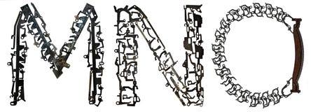 字母表在` M, N,从金属零件装配的O `上写字 库存图片