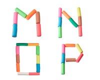 字母表在m n o p彩色塑泥上写字 免版税库存照片
