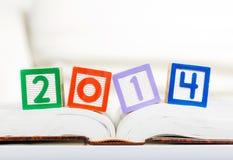 字母表块与2014年在书 免版税库存照片