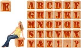 字母表块刻记了孕妇木头 免版税库存照片