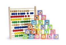 字母表块和算盘 免版税库存图片