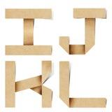 字母表工艺在被回收的origami纸张上写字 免版税库存照片