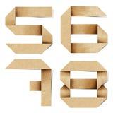 字母表工艺在被回收的origami纸张上写字 库存照片