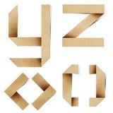 字母表工艺在被回收的origami纸张上写字 免版税图库摄影
