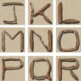 字母表漂流木头j r无缝的盖瓦 库存照片