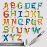 字母表纸被切开的五颜六色的字体 免版税库存图片