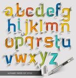 字母表纸被削减的五颜六色的字体风格 免版税库存照片