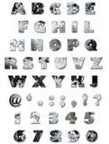 字母表纹理墙壁 免版税库存图片