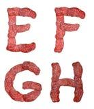 字母表蒜味咸腊肠 库存照片
