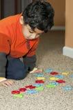 字母表识别编号学龄前儿童对尝试 免版税库存图片