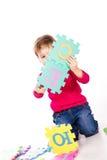 字母表逗人喜爱的女孩一点难题解决 免版税库存照片