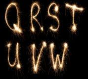 字母表闪烁发光物 库存照片