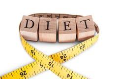 字母表饮食和卷尺 免版税库存图片