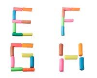 字母表E-F g h在彩色塑泥上写字 图库摄影