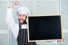 存在产品 把手指指向的人空的委员会 首席厨师教的主要类在烹饪学院 教育  库存图片