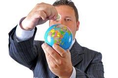 存金钱旅行世界 库存图片