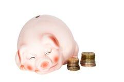 存钱罐和硬币 免版税库存图片