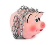 存钱罐和链子 库存照片