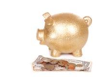存钱罐和货币 免版税库存图片