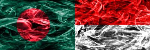 孟加拉国对印度尼西亚肩并肩被安置的烟旗子 孟加拉国和印度尼西亚的浓厚色的柔滑的烟旗子 库存例证