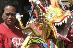 季节性喇叭玩具贸易商在新年2014年 库存照片