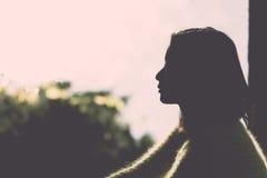 孤独的妇女剪影  图库摄影