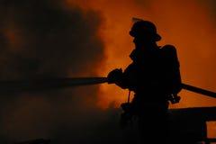 孤立的消防队员 免版税图库摄影