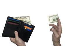 孤立 一个人` s钱包在一只手上 那里` s每100美元在另一只手上 图库摄影