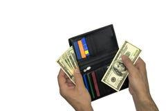 孤立 班珠尔 在人` s钱包的手和100美元票据上  免版税库存照片