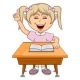 学习与学校桌动画片的女孩 库存图片