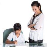 学习与老师我的年轻学校女孩 库存图片