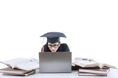 学习与膝上型计算机和书1的学士 免版税库存照片
