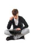 学习少年的查出的膝上型计算机 免版税库存图片