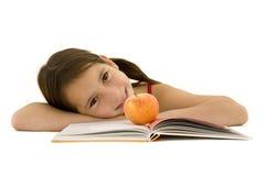 学习年轻人的女孩 免版税库存图片