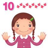 学会数字和计数用显示数字t的kid's手 库存照片