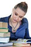学员女孩读一本书 免版税库存照片