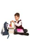学员男孩为家庭作业做准备 免版税库存图片