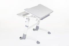 学校书桌和椅子灰色 免版税库存照片