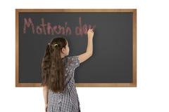 学校在黑板的女孩文字 库存图片