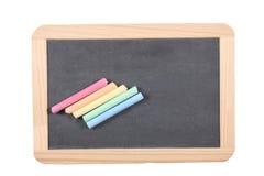 学校概念:关闭在有在白色背景和裁减路线隔绝的白垩的板岩黑板 库存照片