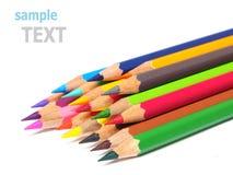 学校用品在白色上色铅笔削片被隔绝 免版税库存照片