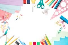 学校用品框架,隔绝在白色 库存照片