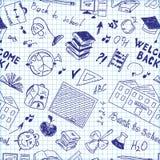 学校用品的无缝的样式在笔记本的 库存图片